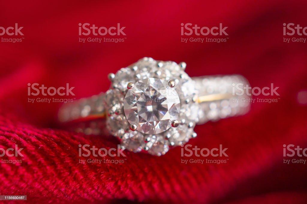 luxury jewelry diamond ring on red fabric background