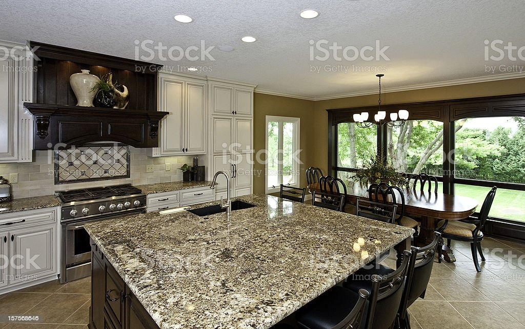 Newly renovated kithcen and dining area with large granite-topped...