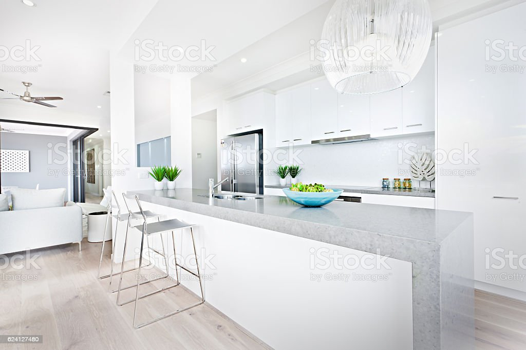 Luxury kitchen chairs and hanging lights with white walls stock photo