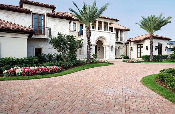 luxury living in this beautiful estate home with brick pavers - stately home stock photos and pictures