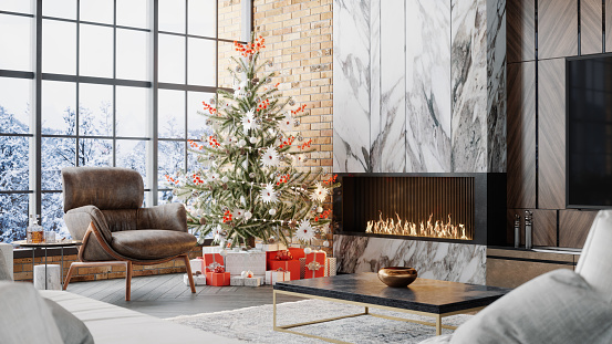 Fireplace, christmas tree and presents in a luxurious chalet with snowy mountain view.