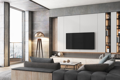 Interior of a luxurious living room with television set.