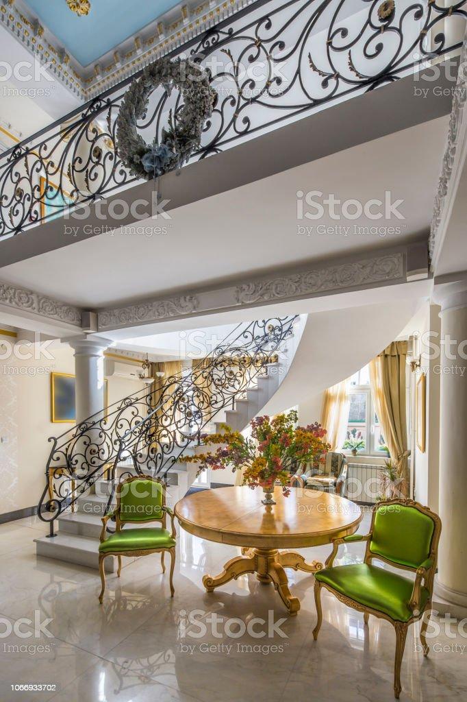 luxury lobby interior. Staircase with handmade wrought Iron Railing