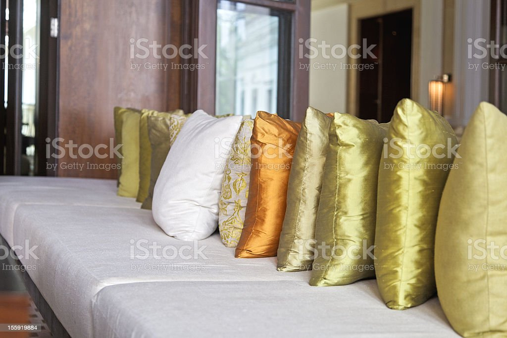 Luxury lounge seating with scatter cushions royalty-free stock photo