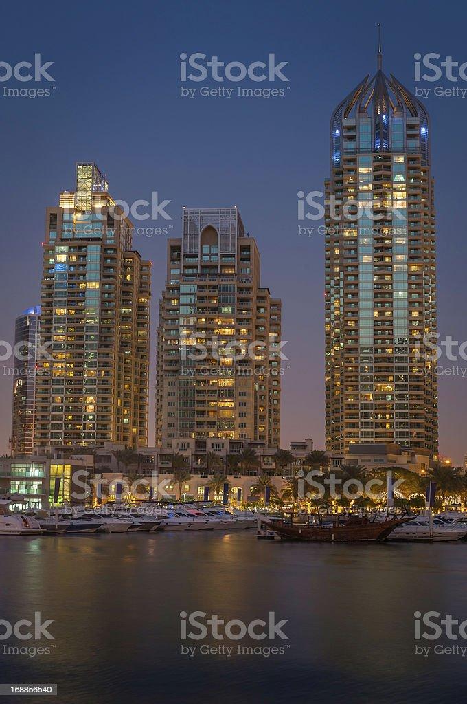 Luxury marina apartments illuminated at dusk Dubai waterfront royalty-free stock photo