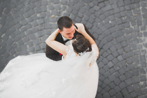 Luxury married wedding couple, bride and groom posing in old city stock photo