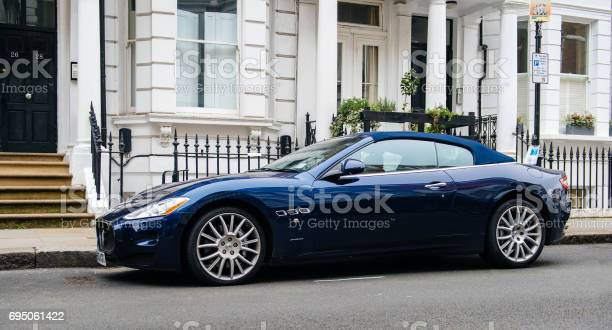 Luxury maserati blue grancupe in front of english townhouse picture id695061422?b=1&k=6&m=695061422&s=612x612&h=opvi xmnev7ogox kvhniyc3rj30sdhmo003upt yv4=
