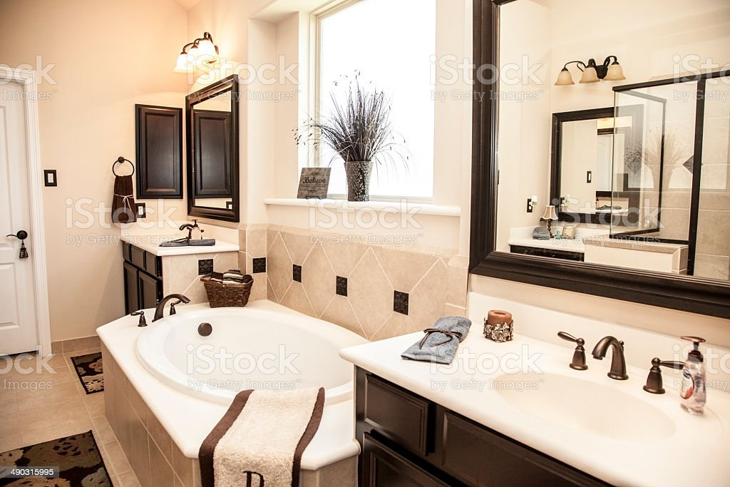 Luxury master bathroom in upscale home. Bathtub, double sinks. stock photo