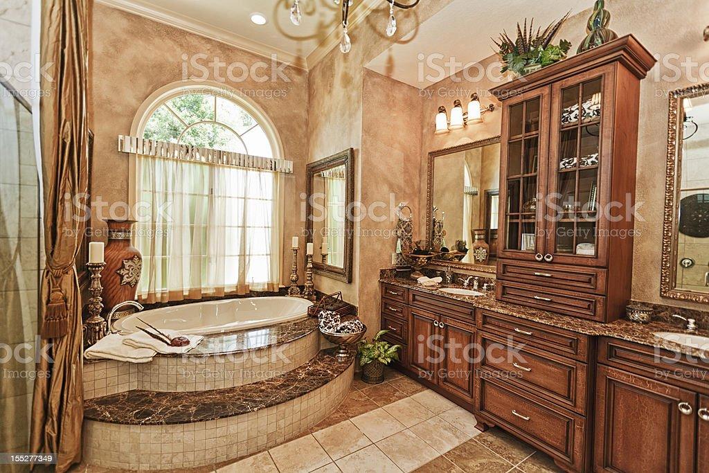 Luxury Master bathroom with custom cabinet work Beautiful tub stock photo