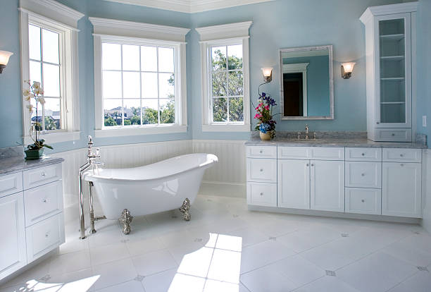 luxury master bathroom with free standing bath tub - drenched stock pictures, royalty-free photos & images