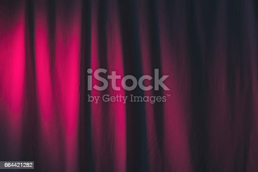 istock Luxury mauve color curtains textile or fabric. 664421282