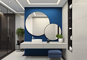 Luxury minimalist bathroom with royal blue wall and large white tiles