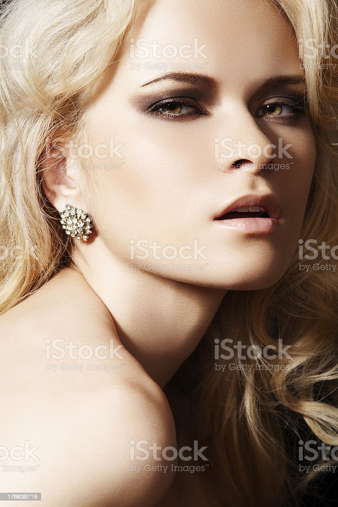Luxury model with diamond earrings and blond hair royalty-free stock photo