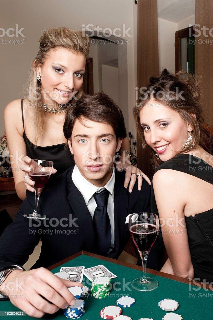 Luxury models playing poker royalty-free stock photo