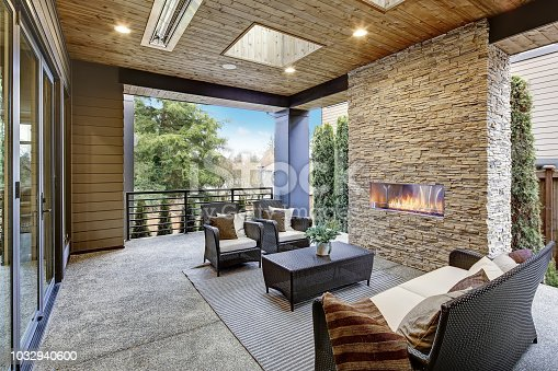 Luxury modern deck exterior with stone fireplace