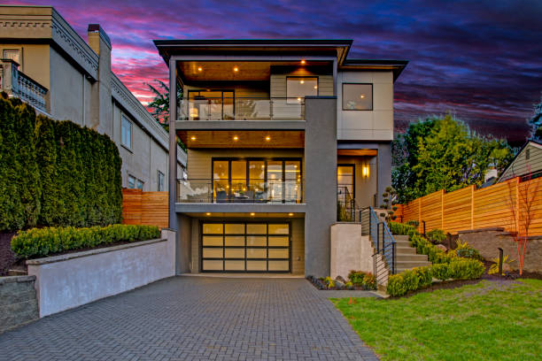 Luxury modern home exterior at sunset stock photo