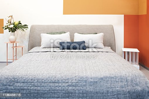 Luxury modern impressionism cubism avant-garde style bedroom and in pink, brown and blue tones, Interior of a bedroom with plush cushions