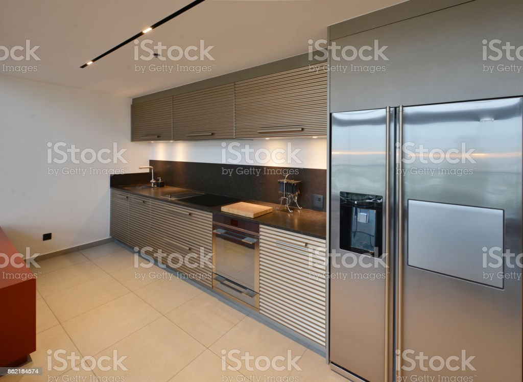 Luxury modern kitchen area and decoration at night on condominium, interior design stock photo