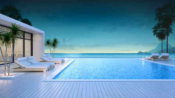 luxury modern style at the exterior beach houses with a private swimming pool,beach lounge at evening,summer paradise ,lounge of the breathtaking view sea and sky/3d rendering - competition group stock photos and pictures