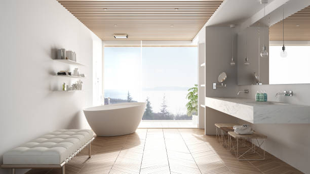 Luxury modern white bathroom with parquet floor and wooden celiling, big panoramic window on sea panorama, bathtub, shower and double sink, interior design, minimal architecture stock photo
