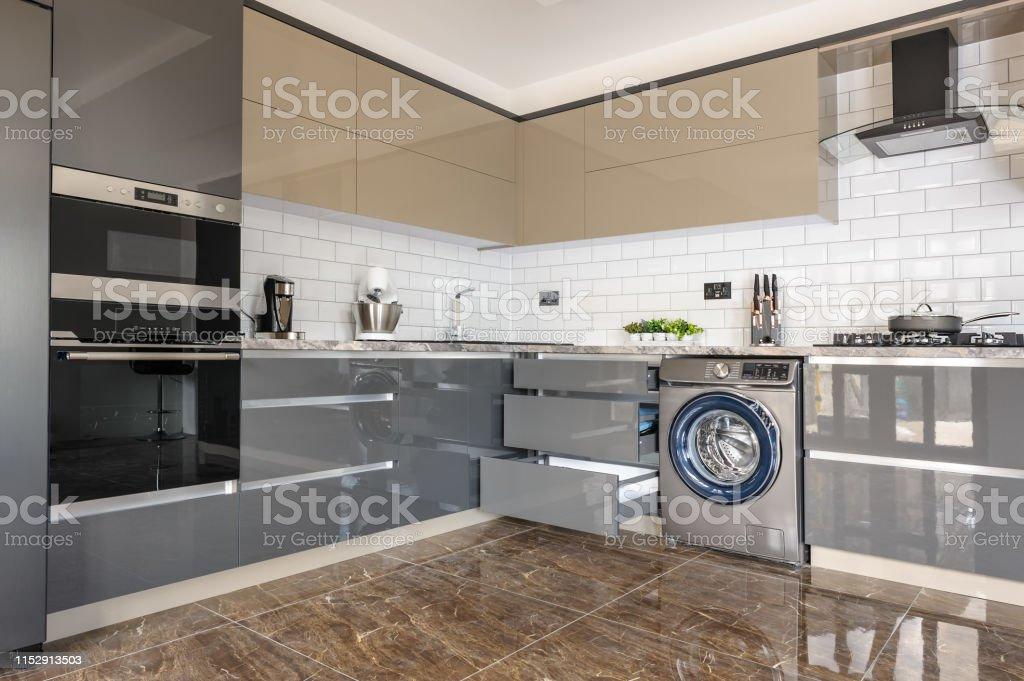 Luxury Modern White Beige And Grey Kitchen Interior Stock Photo
