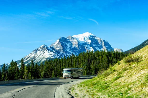 Luxury Motor Home on Road Trip Tour, Banff National Park, Canada Luxury Motor Home on Road Trip Tour, Banff National Park, Canada motor home stock pictures, royalty-free photos & images