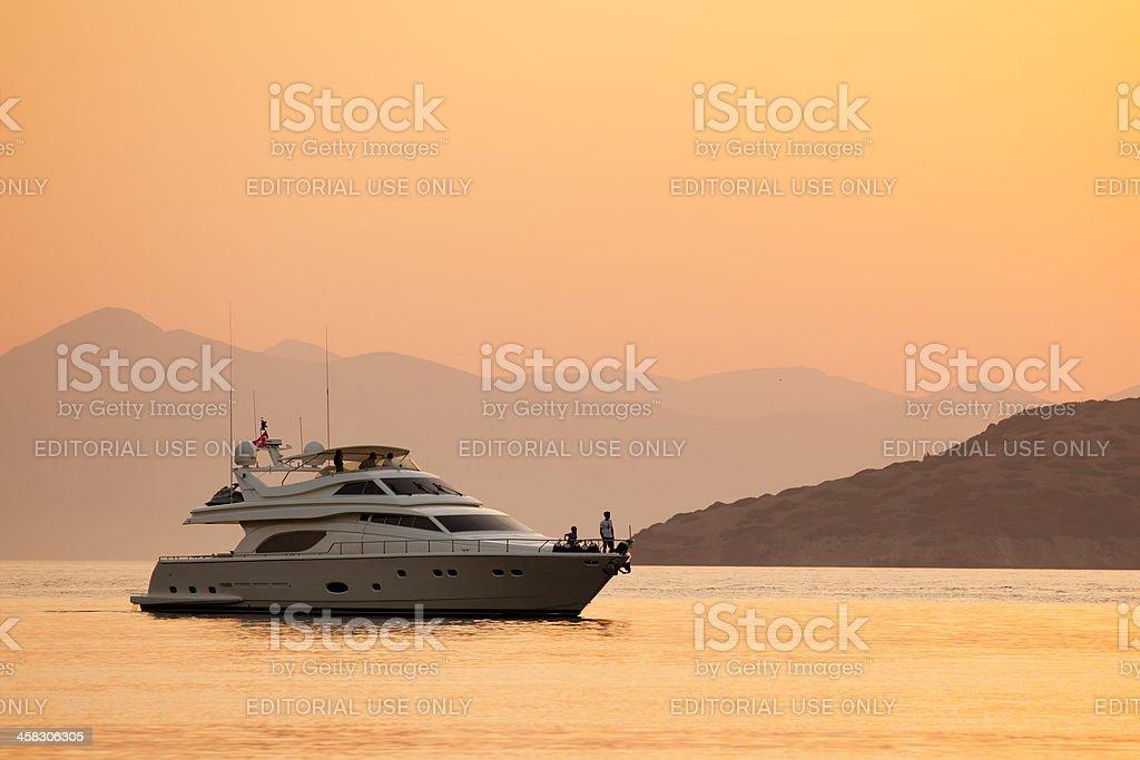 Luxury Motor Yacht Anchored to Gumusluk at sunset stock photo