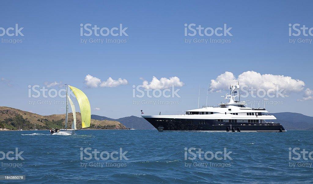 Luxury Motor Yacht and Sailing Boat at Sea stock photo