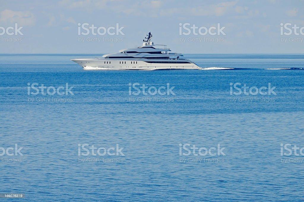 Luxury motor yacht at open sea stock photo