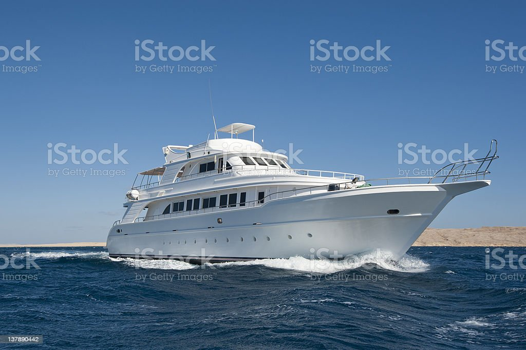 Luxury motor yacht at sea stock photo