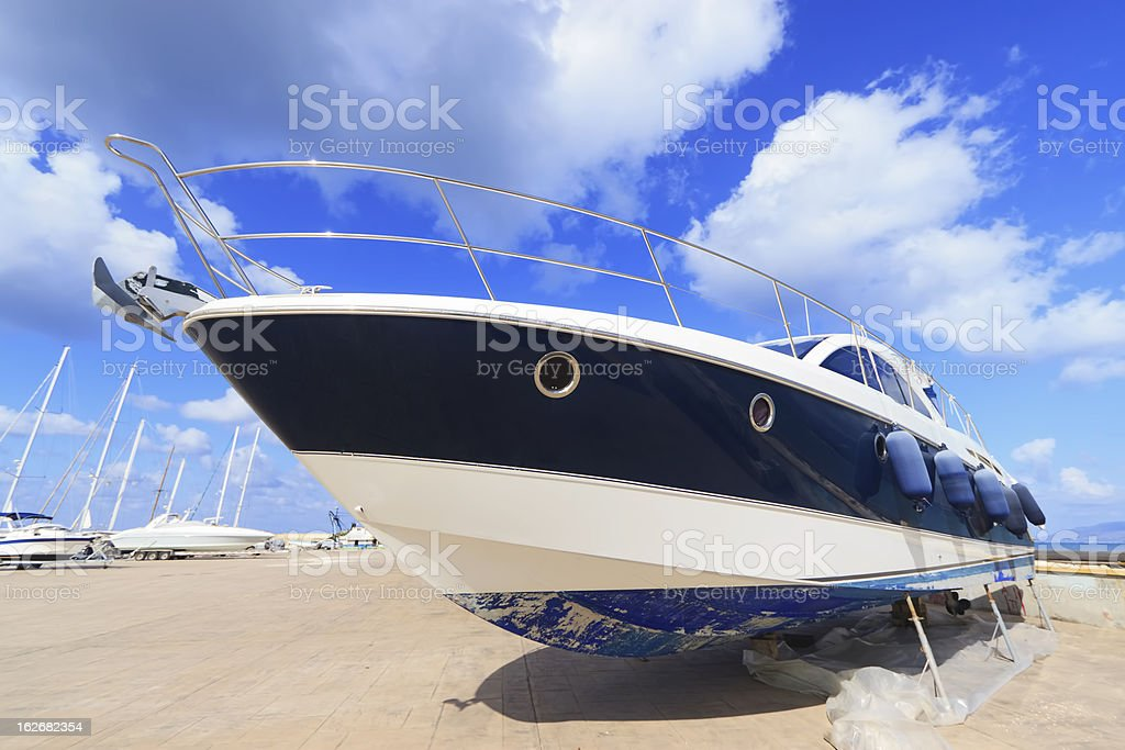 Luxury motor yacht beached at a dock stock photo