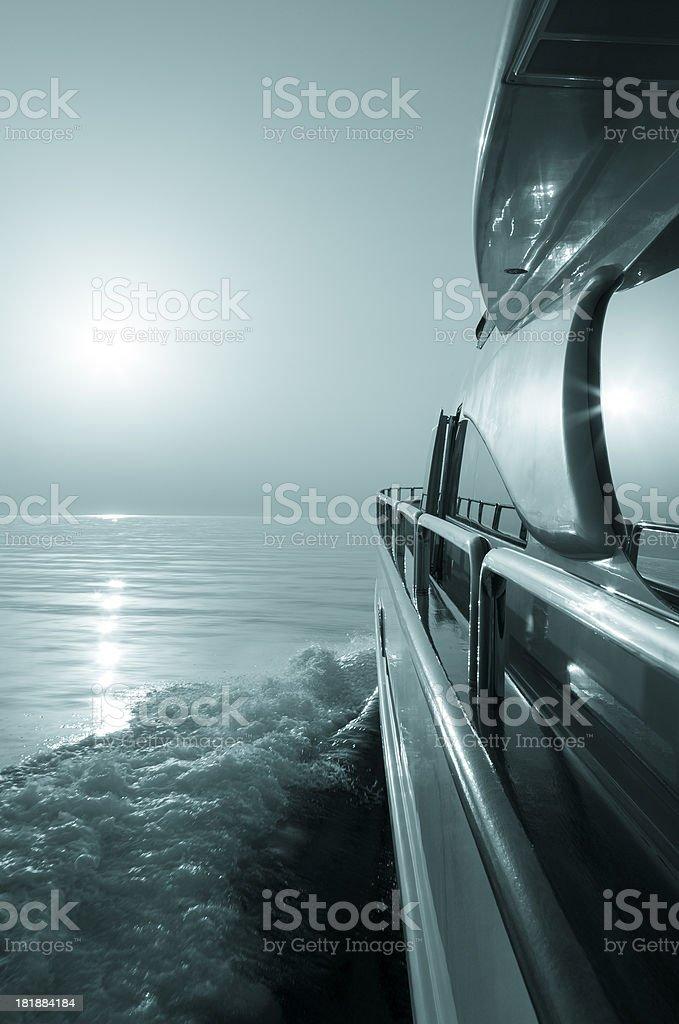 Luxury motor yacht sailing at Sunset. royalty-free stock photo