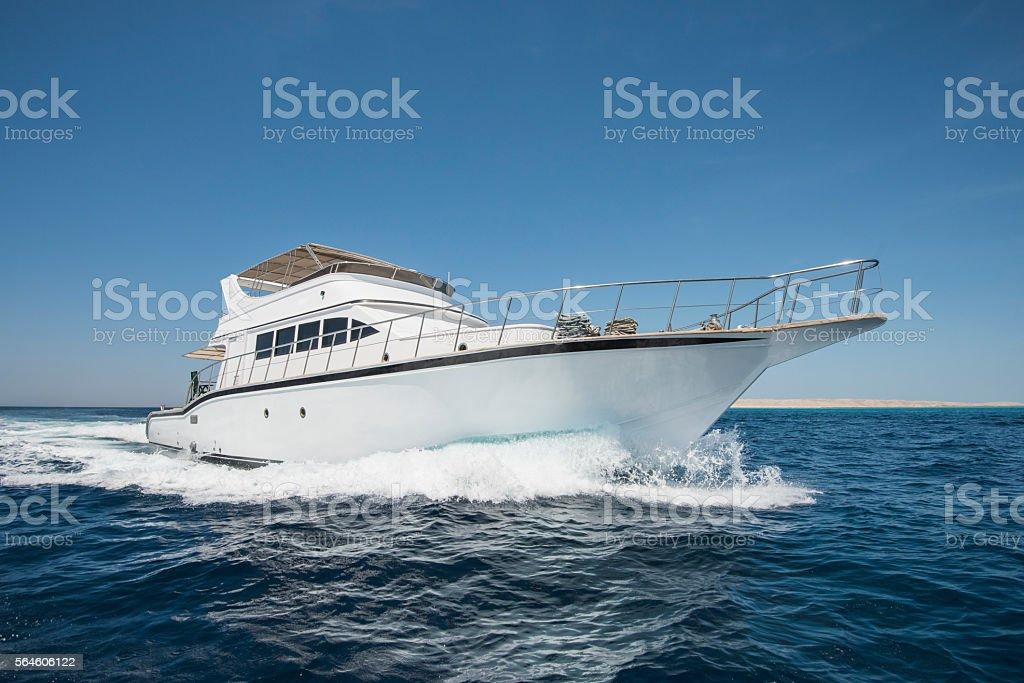 Luxury motor yacht sailing on tropical sea stock photo