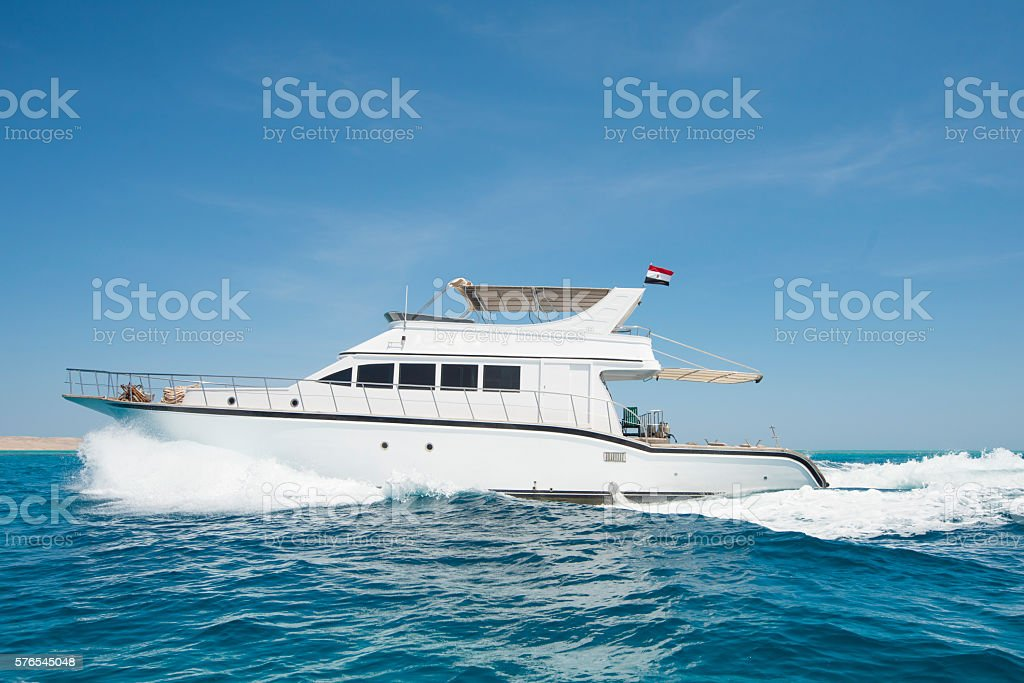 Luxury motor yacht sailing on tropical sea - Photo