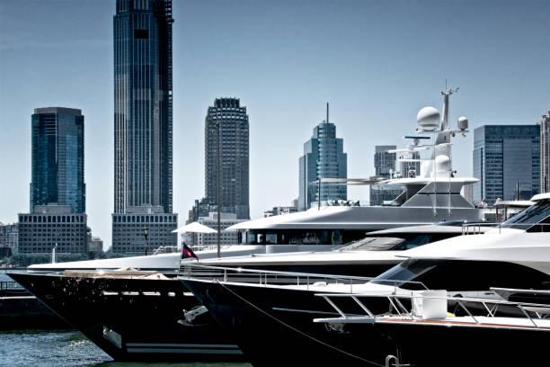 Luxury Motor Yachts at North Cove Marina, Lower Manhattan Financial District, Hudson River, New York City, USA stock photo
