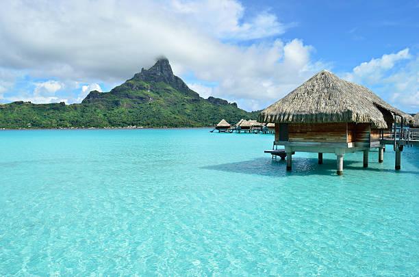 luxury overwater vacation resort on bora bora island - bungalow stock photos and pictures