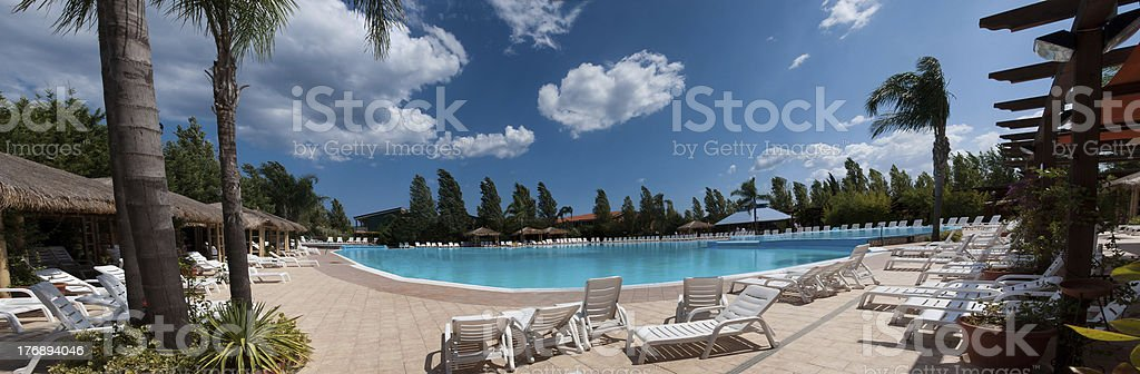Luxury pool and palm tree royalty-free stock photo