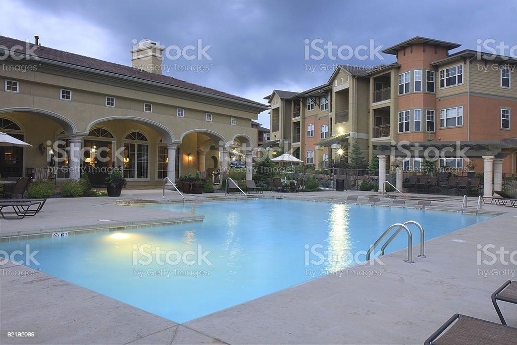 Luxury pool at dusk stock photo