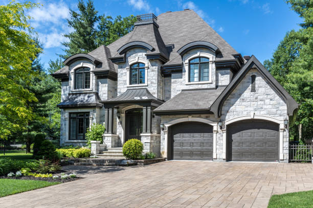Luxury Property on Sunny Day of Summer Terrebonne, Canada - June 25, 2017: Luxurious property located in Le Boisé de la pinière neighbourhood, a rich suburb of Terrebonne on a sunny day of summer. stone house stock pictures, royalty-free photos & images