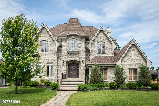 Luxurious property located in Le Fontainebleau, Blainville neighbourhood, a rich suburb of Montreal on a sunny day of summer.