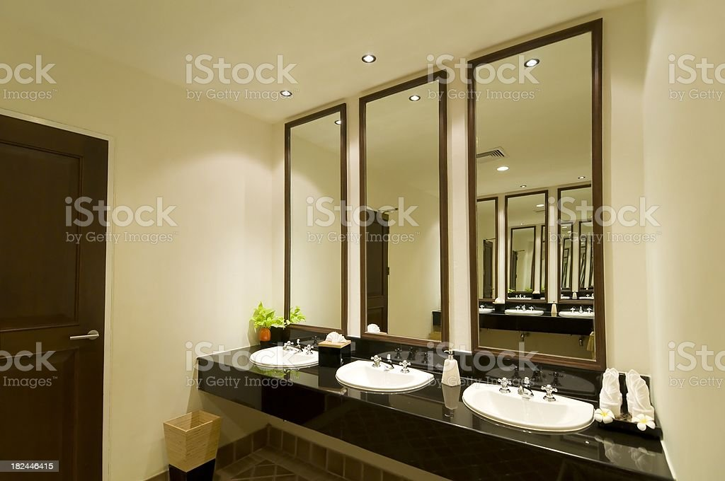 Luxury public restroom with sink and mirror royalty-free stock photo