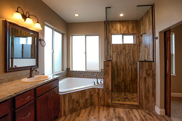 luxury residential master bathroom - badewanne holz stock-fotos und bilder