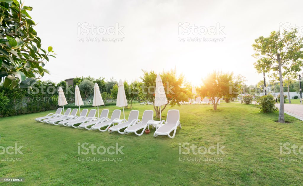 luxury resort hotel garden with lounge chair royalty-free stock photo