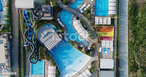 1082419790 istock photo Luxury resort hotel  Swimming Pool with water park aerial view 907614878