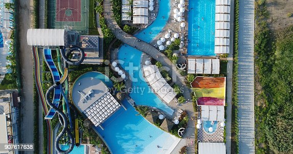 1082419790 istock photo Luxury resort hotel  Swimming Pool with water park aerial view 907617638