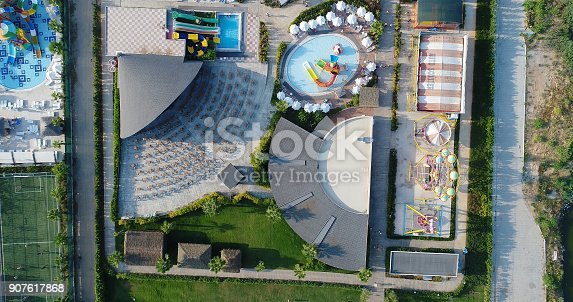 1082419790 istock photo Luxury resort hotel  Swimming Pool with water park aerial view 907617868