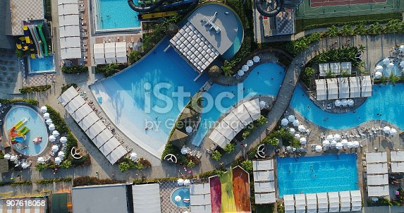 1082419790 istock photo Luxury resort hotel  Swimming Pool with water park aerial view 907618058