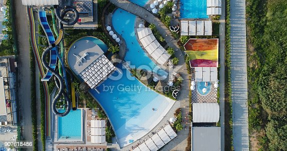 1082419790 istock photo Luxury resort hotel  Swimming Pool with water park aerial view 907618486