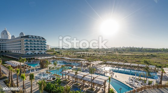 1082419790 istock photo Luxury resort hotel with Swimming Pool aerial view 906498490