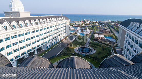 1082419790 istock photo Luxury resort hotel with Swimming Pool aerial view 906502858